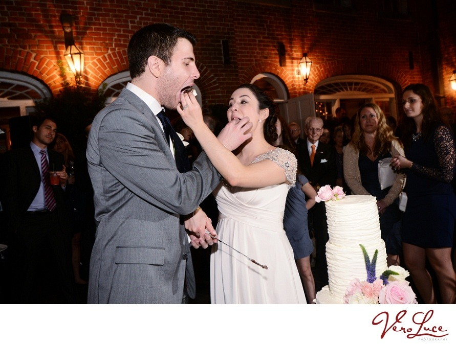 A New Orleans wedding cake cutting | photo by VeroLuce Photography