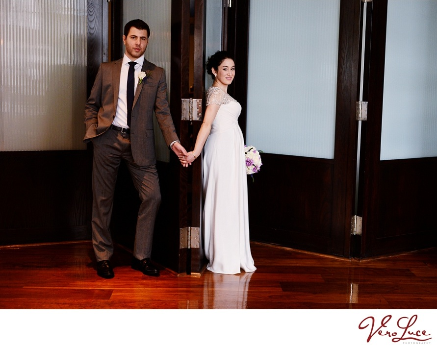"the couples sweet ""first look"" on opposite sides of the door 