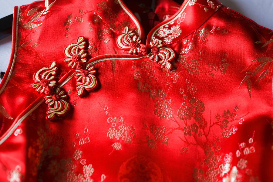 The gorgeous red dress in detail | worn at a Traditional Chinese Wedding Tea Ceremony | photo by Nicole Chan Photography