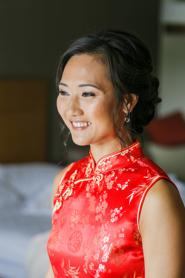 Bride in her red dress for a traditional Chinese Wedding Tea Ceremony | photo by Nicole Chan Photography