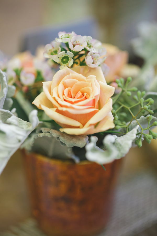 Super Pretty Flower Arrangement in a Terra Cotta Pot from Eight Tree Street | as seen on BrendasWeddingBlog.com