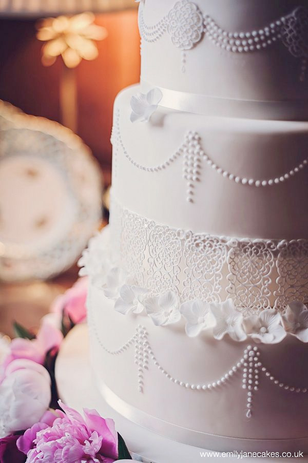 Victorian Themed Wedding Cake with Lace and Beaded Garlands by www.emilyjanecakes.co.uk ~ photo by www.mbishopphotography.co.uk | seen on BrendasWeddingBlog.com {found via english-wedding.com}