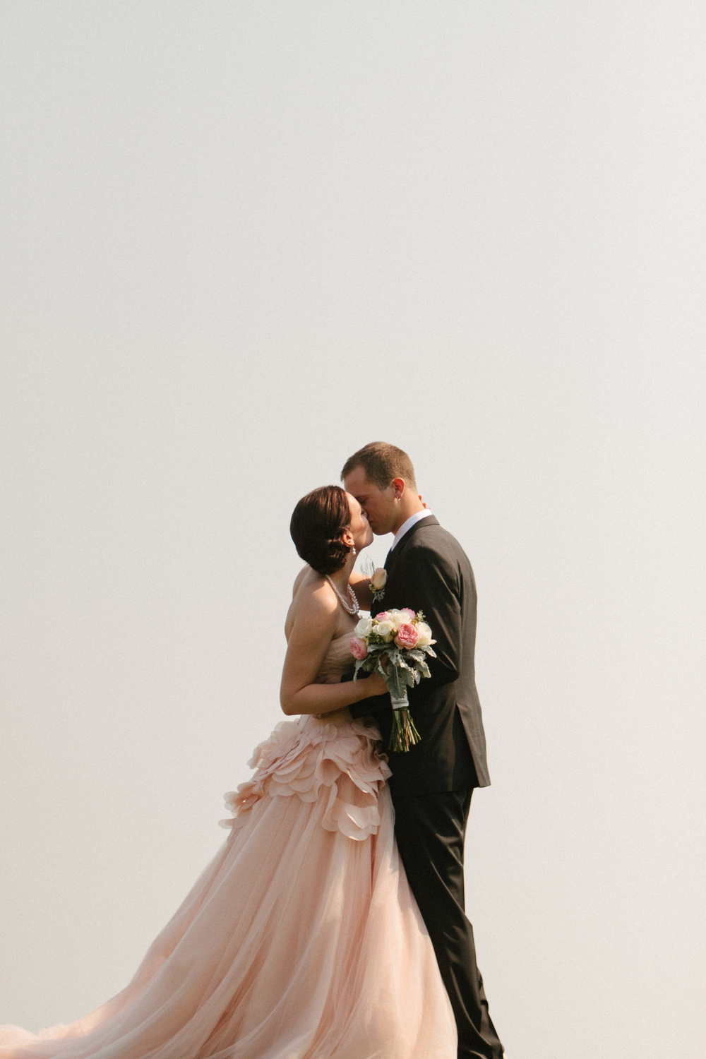 Stunning Photo of the Bride and Groom Kissing | Wedding Gown by Vera Wang | photo by blf Studios | wedding by Madeline's Weddings