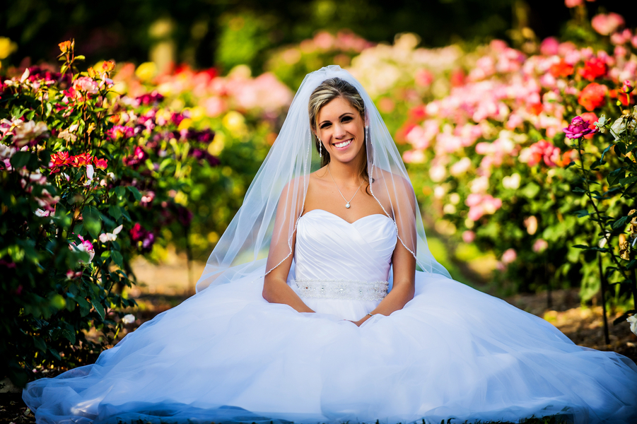 Bride in a Flower Garden | photo by Ross Costanza Photography | as seen on www.BrendasWeddingBlog.com