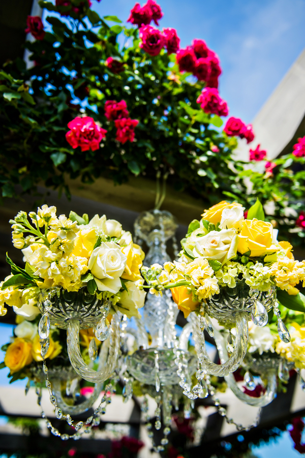 Stunning Floral and Crystal Chandelier | photo by Ross Costanza Photography | as seen on www.BrendasWeddingBlog.com