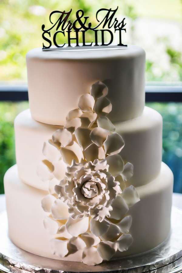 Beautiful White Wedding Cake with Ruffled Flower | photo by Ross Costanza Photography | via www.BrendasWeddingBlog.com