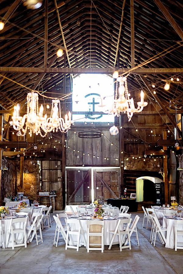 An Elegant Rustic Wedding Reception in a Barn with Chandeliers   Photo by William Innes Photography   via www.brendasweddingblog.com