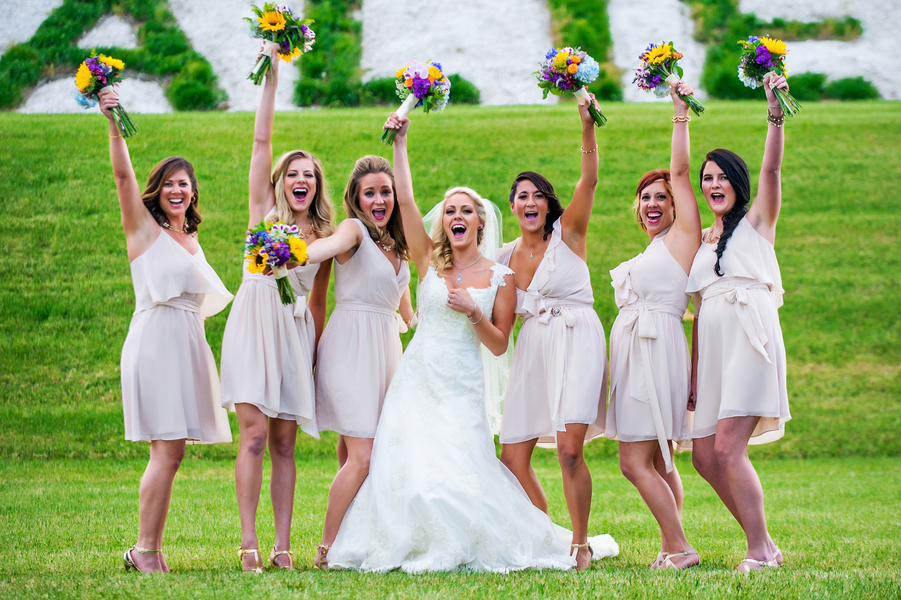 Fun Photo of the Bride and her Bridesmaids | photo by Ross Costanza Photography | as seen on www.brendasweddingblog.com