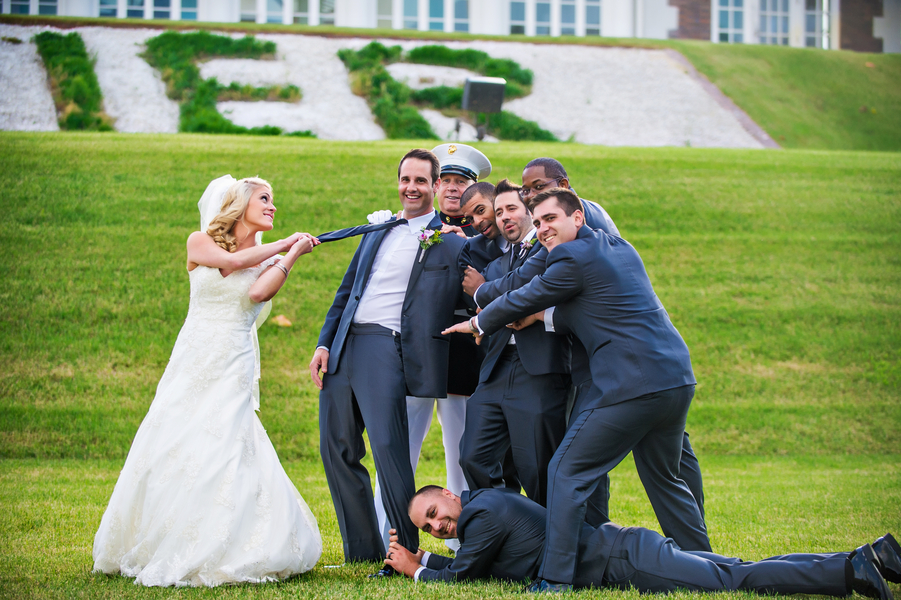 Fun Photo of the Bride with the Groom and Groomsmen | photo by Ross Costanza Photography | as seen on www.brendasweddingblog.com