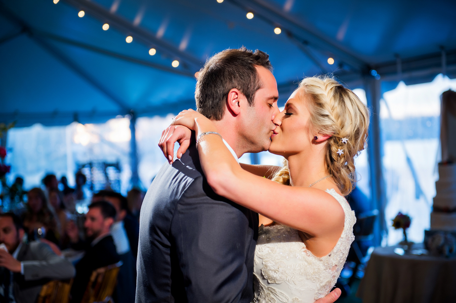 First Dance with a Kiss under the Twinkling Lights | photo by Ross Costanza Photography | as seen on www.brendasweddingblog.com