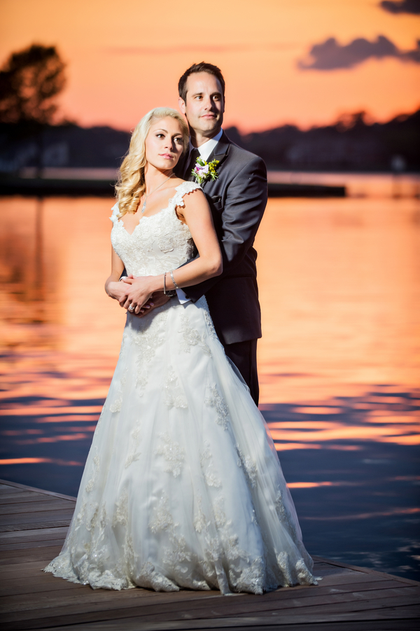 Sunset Portrait of the Bride and Groom | photo by Ross Costanza Photography | as seen on www.brendasweddingblog.com
