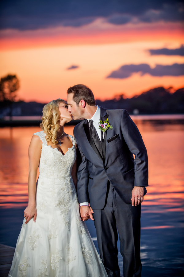 Sunset Portrait of the Bride and Groom Kissing | photo by Ross Costanza Photography | as seen on www.brendasweddingblog.com