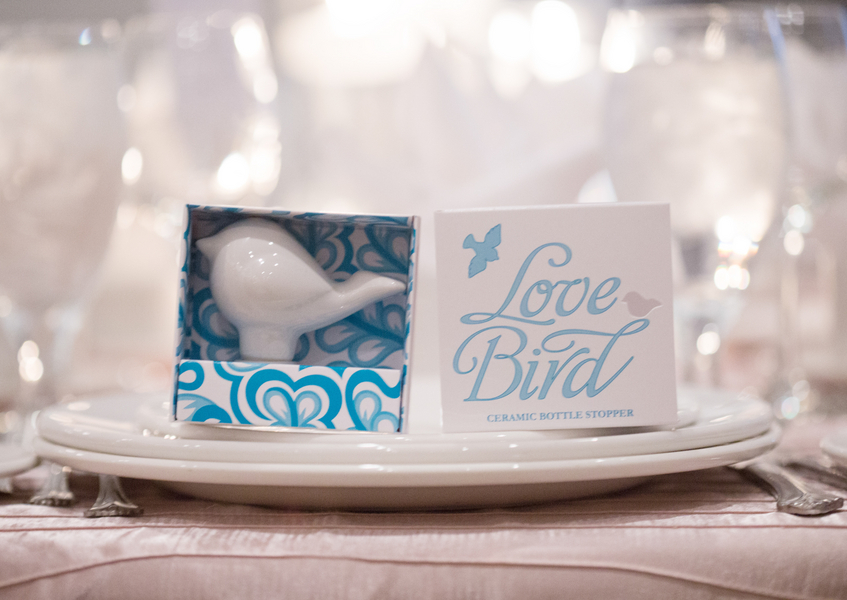 Love Bird Ceramic Bottle Stopper Wedding Favor | photo by Real Image Photography | as seen on www.brendasweddingblog.com