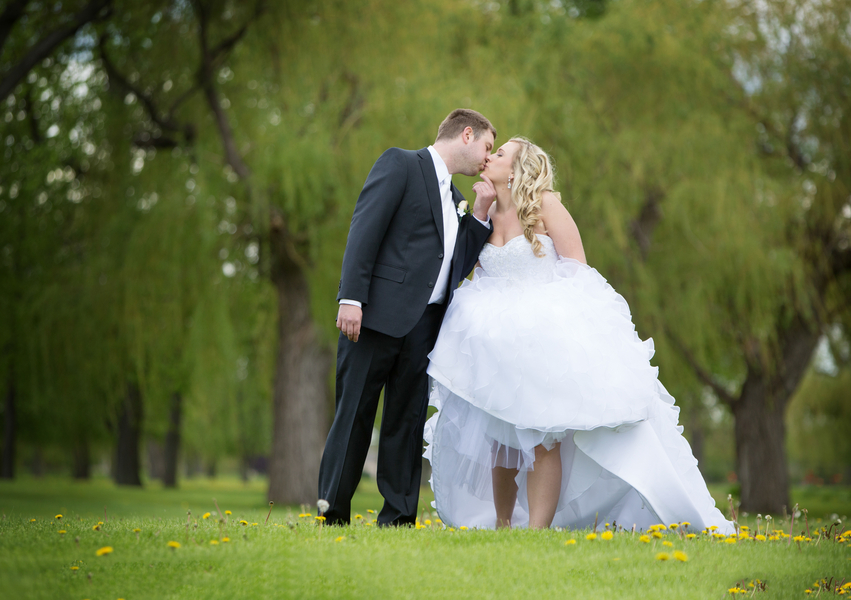 Intimate Bride and Groom Kiss on the Golf Course | photo by Real Image Photography | as seen on www.brendasweddingblog.com