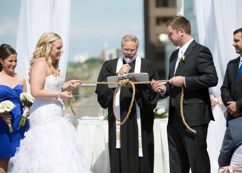 "Wedding Couple ""Ties the Knot"" with a rope 