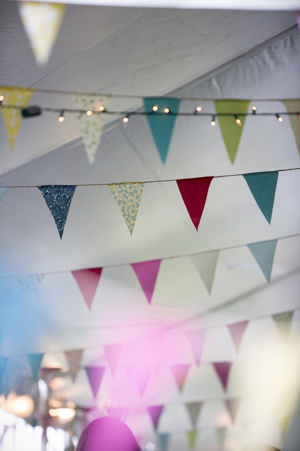 Pretty Fabric Bunting for a DIY Backyard Wedding | photo by Two Sticks Studios | as seen on www.brendasweddingblog.com