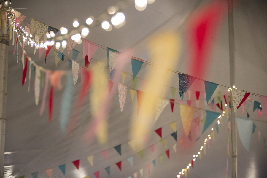 Pretty Fabric Bunting and Twinkling Lights | photo by Two Sticks Studios | as seen on www.brendasweddingblog.com