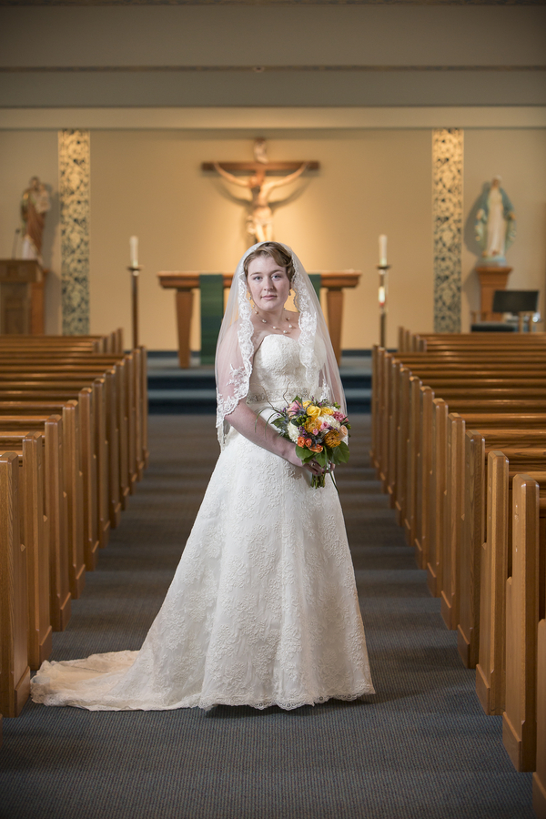 two-stick-studios-091714-sm-bride-front-in-church.jpg