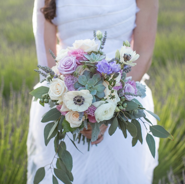 Gorgeous Wedding Bouquet with Lavender, Succulents, Anemones and Roses | photo by Ashley Cook Photography | as seen on www.BrendasWeddingBlog.com