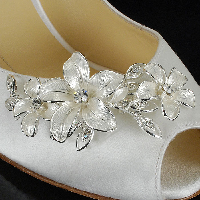 Add Bling to Your Wedding Shoes with Custom Decorations {shown with pearl-white flowers that are surrounded by silver leaves and small crystals / as seen on www.BrendasWeddingBlog.com