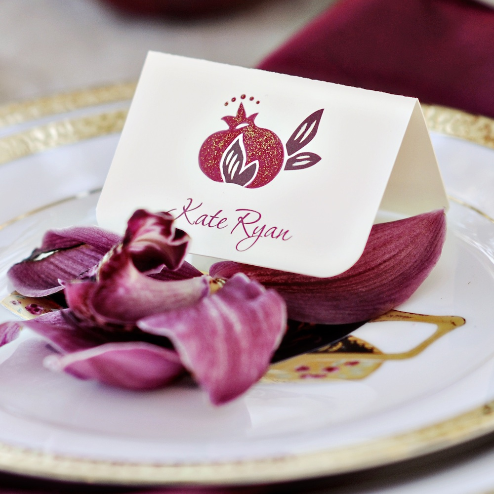 Pomegranate Wedding Place Cards with Hand-Painted Glitter / from a Winter Wedding Inspired Photo Shoot / photo by Kismis Ink Photography / Design by Wedding Girl on Etsy / as seen on www.BrendasWeddingBlog.com