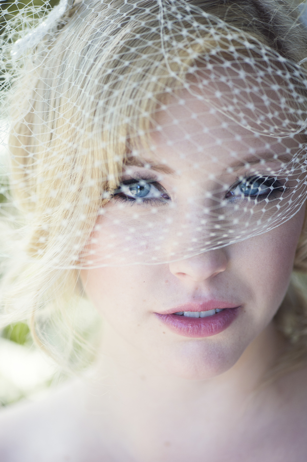 Gorgeous Makeup on a Bride in her Birdcage Veil / photo by L'Estelle Photography / as seen on www.BrendasWeddingBlog.com