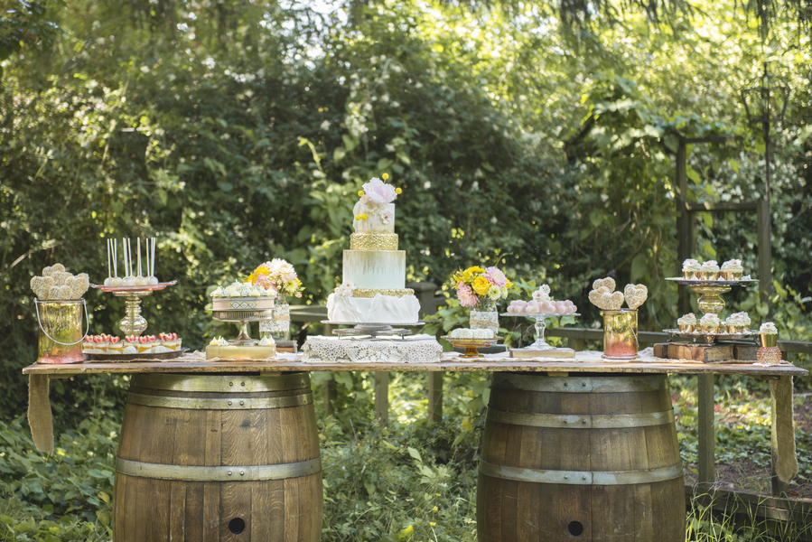 A Rustic Dessert Table  {supported by wine barrels}  / styled by D'Love Affair Weddings & Events / photo by L'Estelle Photography / as seen on www.BrendasWeddingBlog.com