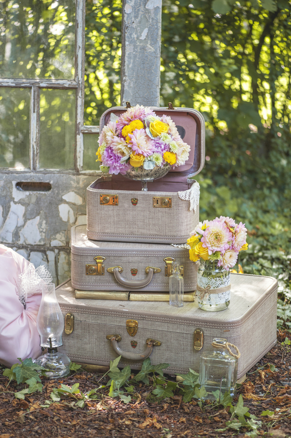 Vintage books and suitcases are the perfect prop for this Rustic Garden Inspired Wedding / styled by D'Love Affair Weddings & Events / photo by L'Estelle Photography / as seen on www.BrendasWeddingBlog.com