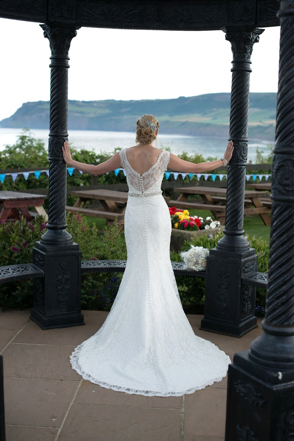 The Gorgeous Back of the Brides Wedding Dress / Seaside Wedding in the UK | photo by Tracey Ann Photography / as seen on www.BrendasWeddingBlog.com
