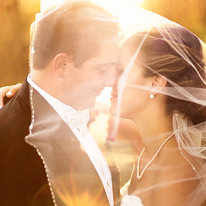 Stunning Photo of the Bride and Groom at Sunset / photo by Morgan Lindsay Photography / as seen on www.BrendasWeddingBlog.com