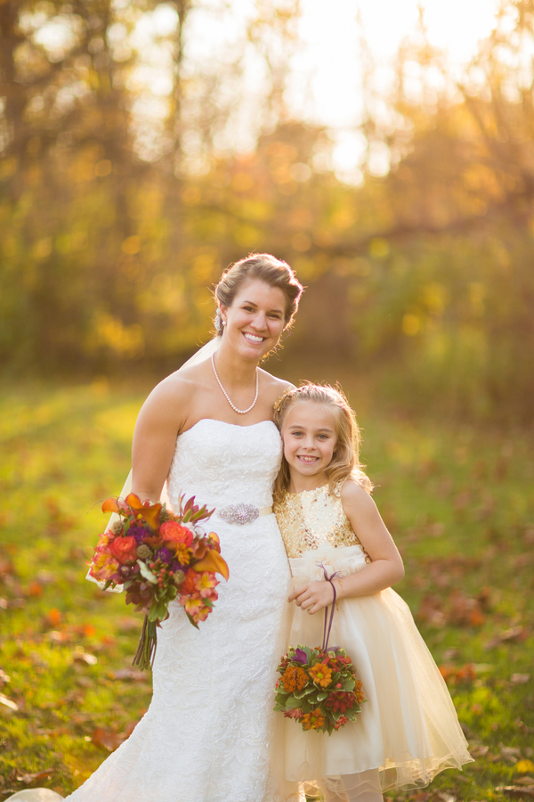 Bride and her Flower Girl at a Fall Wedding / photo by Morgan Lindsay Photography / as seen on www.BrendasWeddingBlog.com