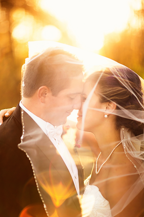 Spectacular Lighting in this Bride and Groom Portrait from their Fall Wedding / photo by Morgan Lindsay Photography / as seen on www.BrendasWeddingBlog.com