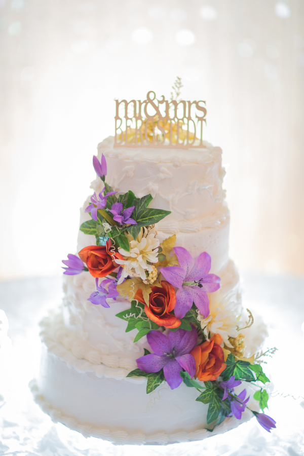 White Wedding Cake with Cascading Flowers + Mr & Mrs Cake Topper - created by the brides aunt / photo by Morgan Lindsay Photography / as seen on www.BrendasWeddingBlog.com