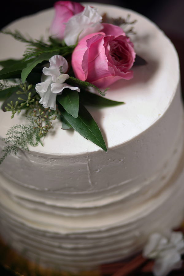 Sweet White Cake {Detail} Topped with Flowers for a Spring Wedding / cake by Amanda Bakes / photo by Corey Lynn Tucker Photography / as seen on www.BrendasWeddingBlog.com