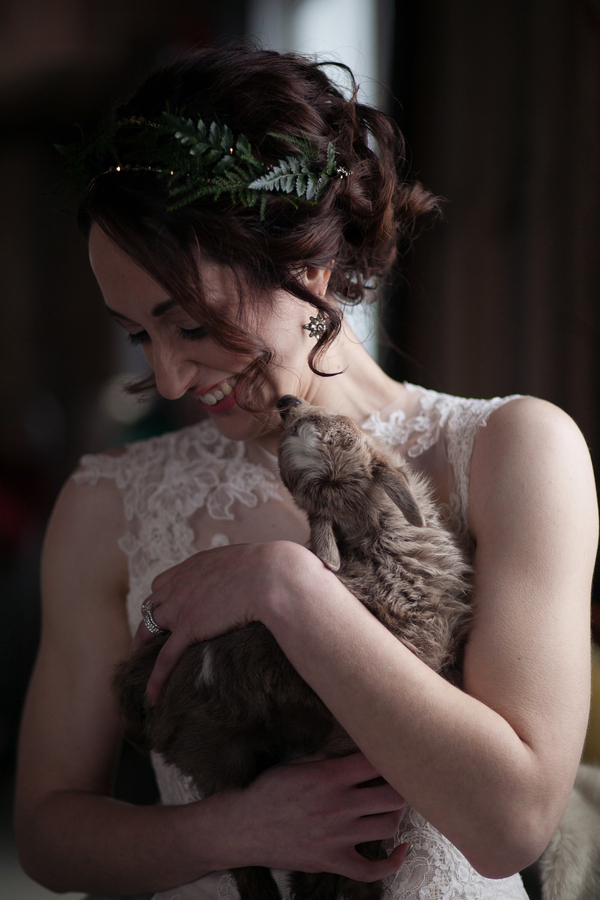 Bride being kissed by a baby goat / photo by Corey Lynn Tucker Photography / as seen on www.BrendasWeddingBlog.com