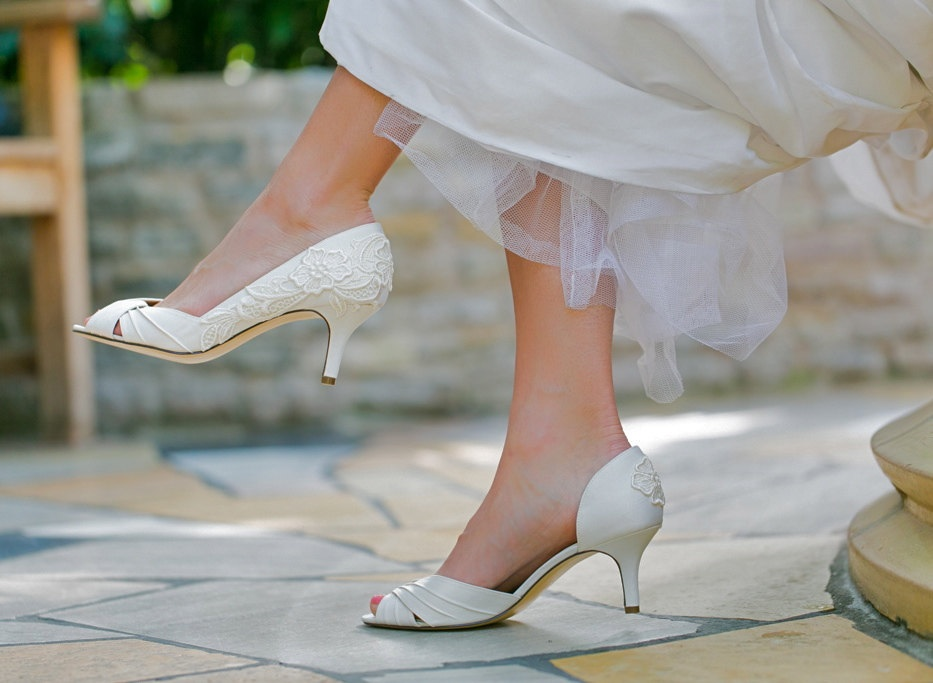 Ivory satin peep-toe wedding pump embellished with an ivory venise lace applique