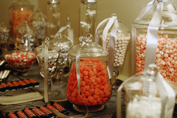 Orange and white candy buffet - created by Madeline's Weddings & Events / as seen on www.BrendasWeddingBlog.com