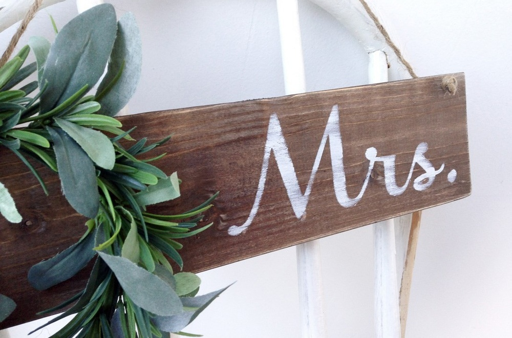 Wooden Wedding Mrs Sign decorated with a green wreath / as seen on www.BrendasWeddingBlog.com