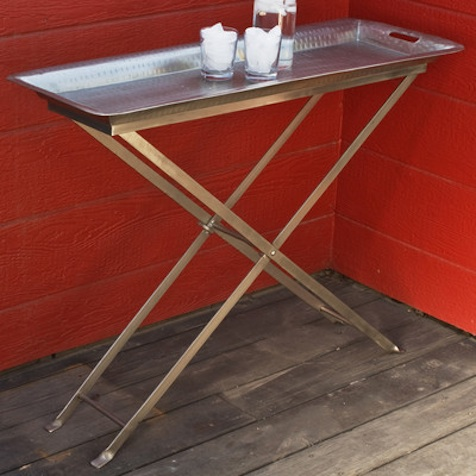 The Wildon Home Antique Butterfly Tray Table is perfect when you need a little extra space for food or drinks