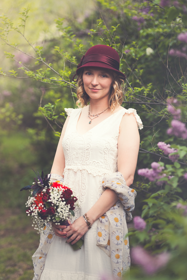 The Bride in her Maroon Hat at her Colorado Wedding / photo by Annabelle Denmark Photography