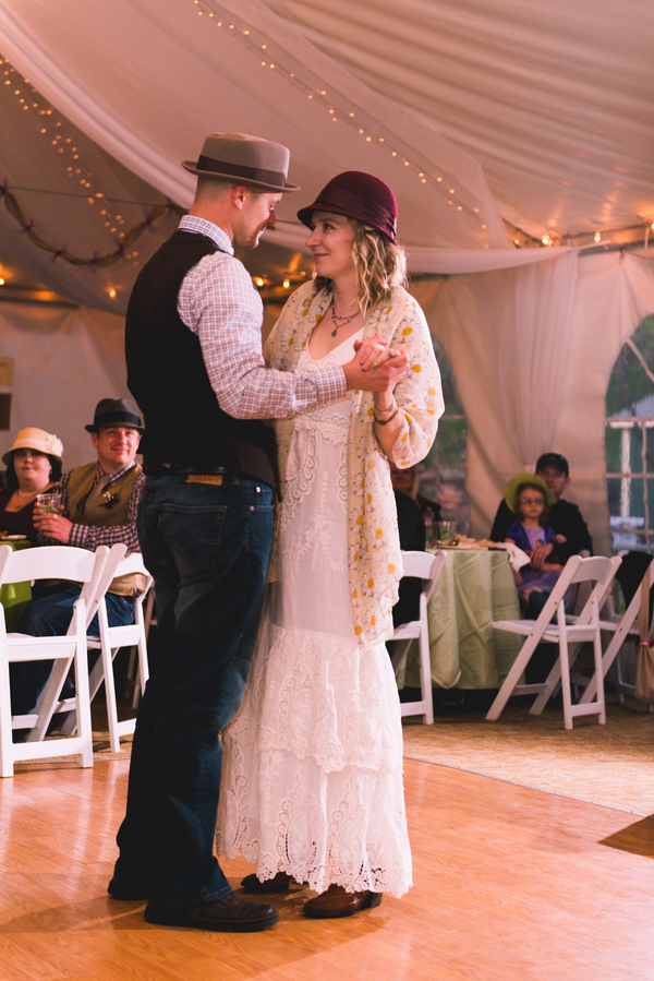 The Bride and Groom in their Hats for their First Dance at their Colorado Wedding / photo by Annabelle Denmark Photography