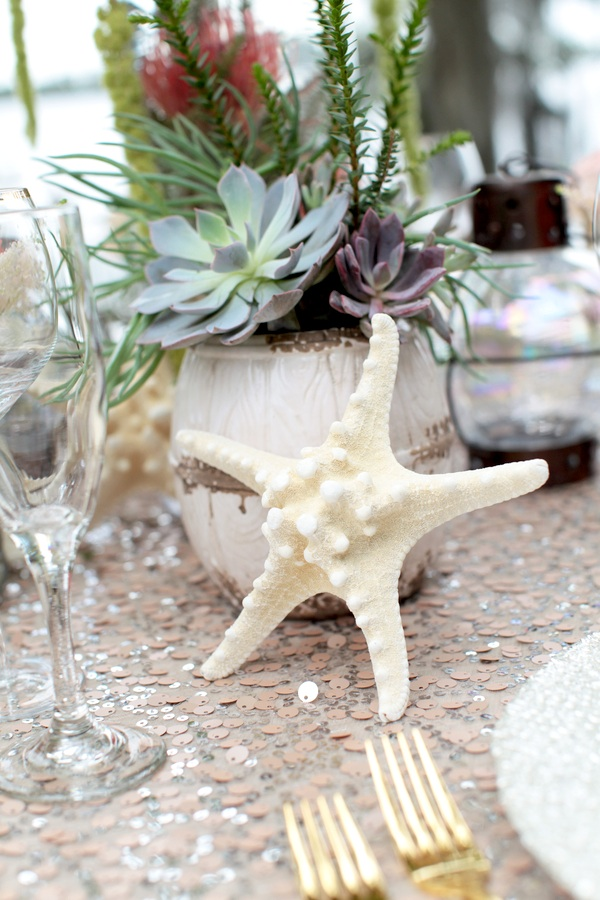 The Perfect Beach Centerpiece - succulents, starfish and sequins Pretty Under the Sea Inspired Wedding Table Display  / photo by Tab McCausland Photography