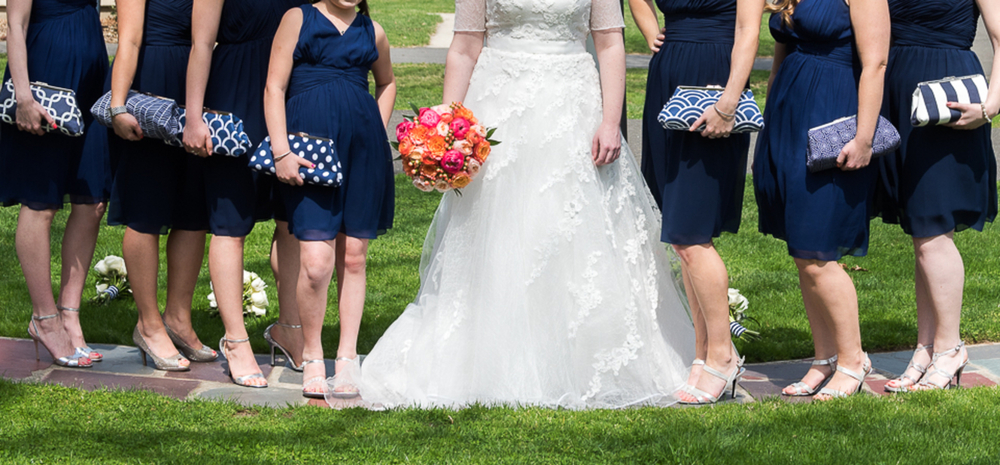 Love the mis-matched bridesmaids clutches in this New Jersey Real Wedding / photo by Havana Photography