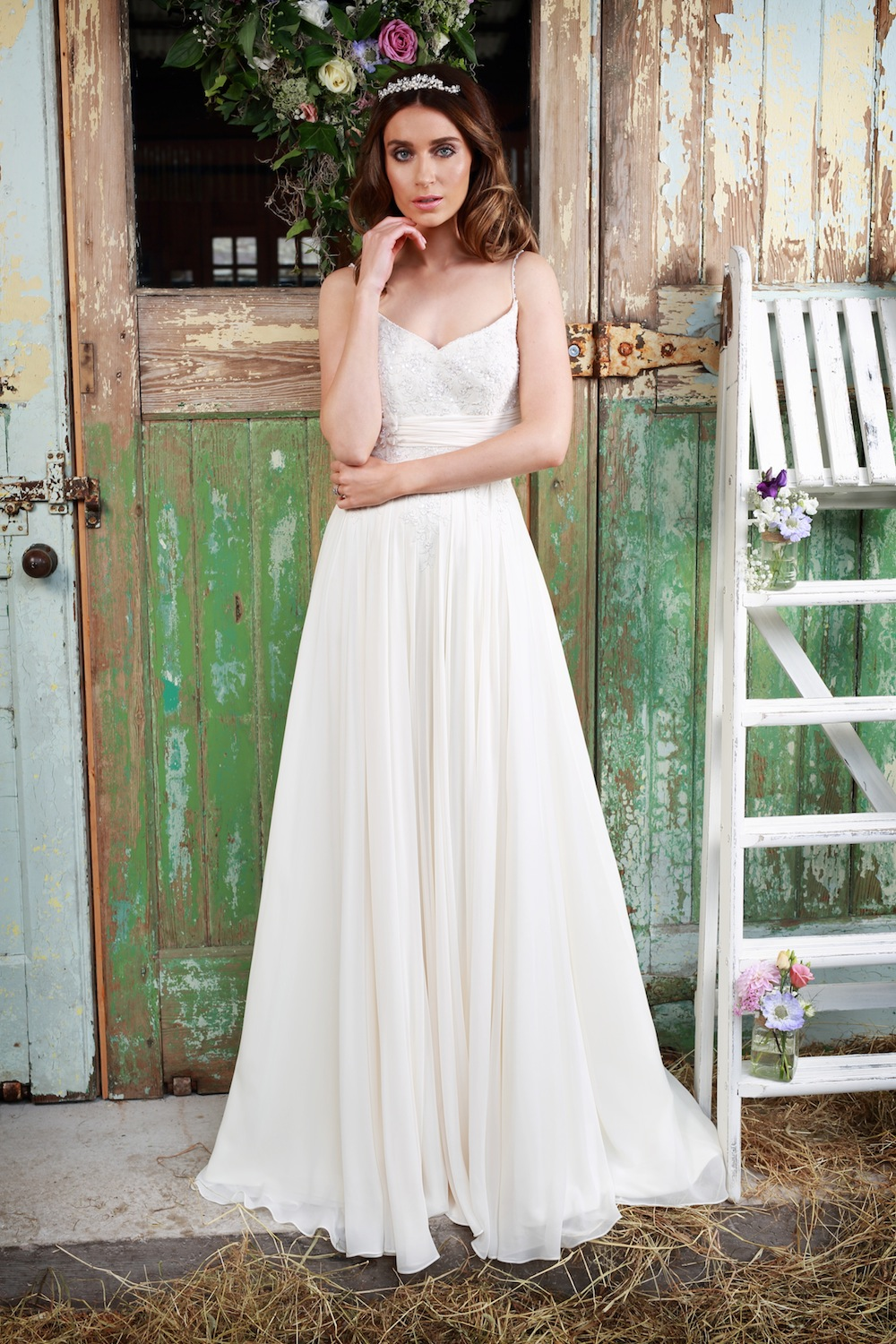 Amanda Wyatt 2016 Wedding Gowns : Leia - great gown for a beach wedding with 14-yards of chiffon. Slim straps move down to a tantalizing bodice accentuated with delicate pearls.