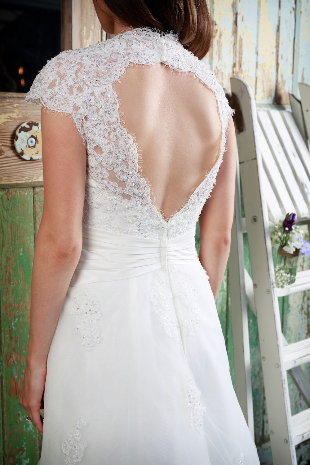 Amanda Wyatt Wedding Gown : Matilda - sweetheart necklace lace gown in fine tulle with guipure lace trim. A pleated satin band helps define a brides waistline down to the A-line skirt with a keyhole back.