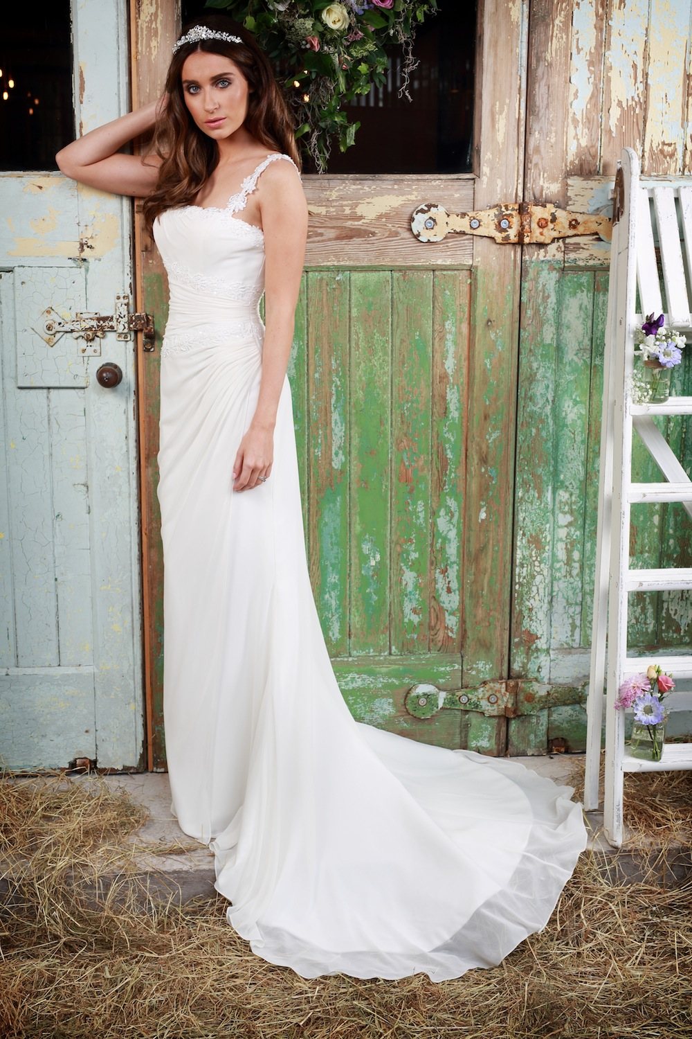 Amanda Wyatt Wedding Gown : Rochelle - square neck is finished with flower detailed straps. The delicate material is delicately pleated to sweep around and show off a brides shape wonderfully.
