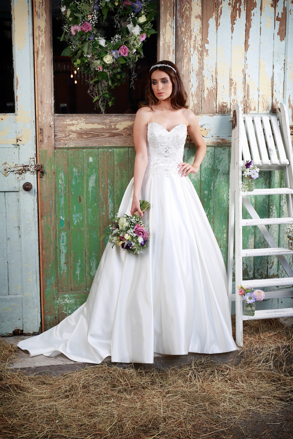Amanda Wyatt Wedding Gown : Sapphire - beading on this bodice sparkles and the lovely hanging pearls on the waist give it lovely definition to the waistline. The full skirt can be worn either with or without a petticoat.
