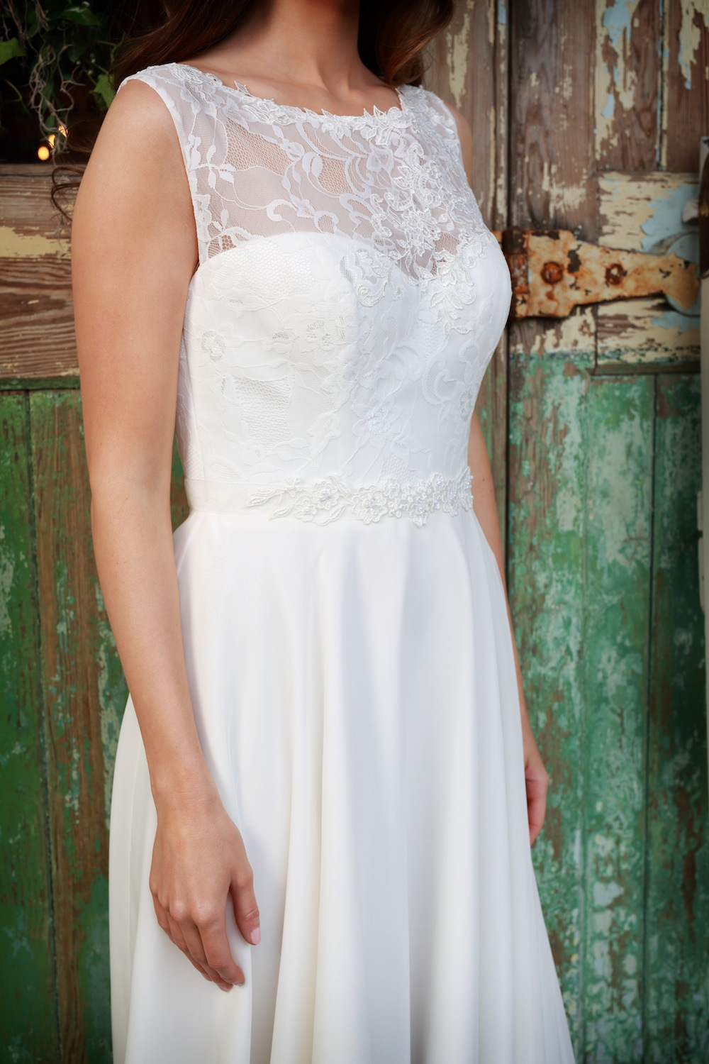 Amanda Wyatt Wedding Gown : Tamsin - luxurious chiffon gown with over 12 yards of fabric in the skirt and a soft lace bodice overlaid with cotton lace motifs.