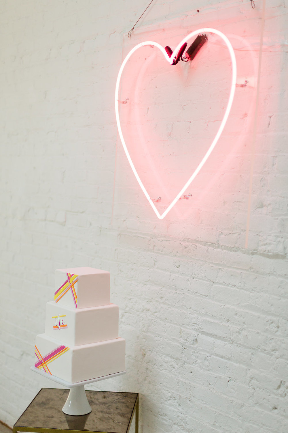 Modern Neon Wedding Cake / designed by Ashley Peraino + Ivey Weddings & Events / Cake by Erica O'Brien Cake Design / photo by Jessica Haley Photography