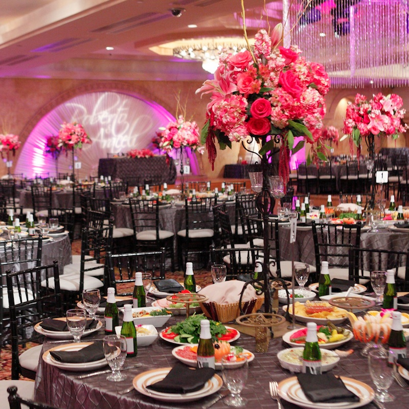 Wedding Reception Idea : go all out and combine chandeliers, elegant linens, illuminated name + lush florals / from Anoush Banquet Halls & Catering in CA